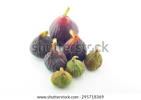 Assorted variety of ripe purple and green sweet figs isolated on white background. - stock photo