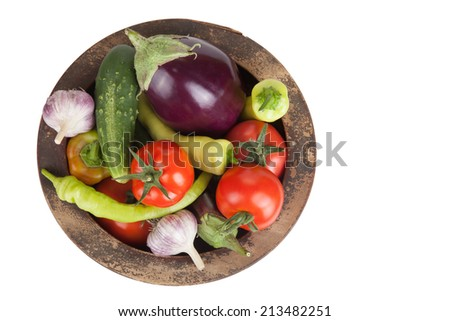 assorted vegetables in an old wooden bowl isolated on white background  - stock photo