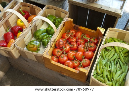 Assorted vegetables in baskets at a farmers market - stock photo