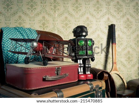 Assorted vintage items in the attic with retro wallpaper background. - stock photo