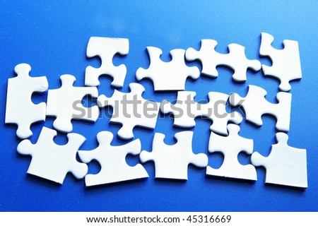 assorted white puzzle pieces on blue surface