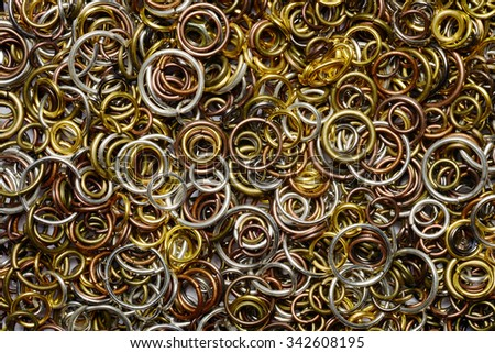 Assorted wire rings backdrop closeup - stock photo