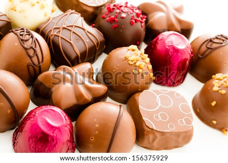 Assortedgourmet chocolate candies in different shapes and colors.