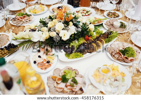Assortie of the wedding meals and beautiful bouquet - stock photo