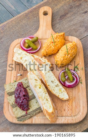 Assortie pates on a wooden plate. - stock photo