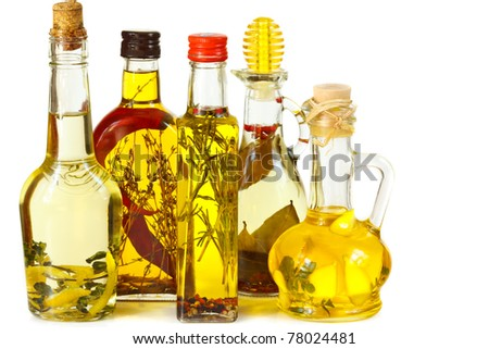 Assortment aromatic olive oil with herbs and spices. - stock photo