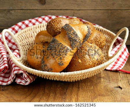 assortment bread (rye, white long loaf, whole-grain cereal bun) - stock photo
