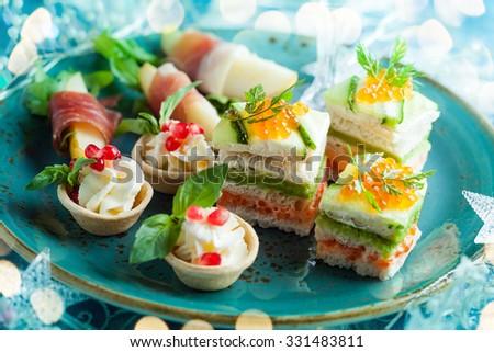 Assortment festive appetizers on the plate - stock photo
