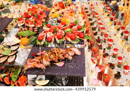 Assortment festive appetizers on the plate, selective focus. Festive buffet  - stock photo