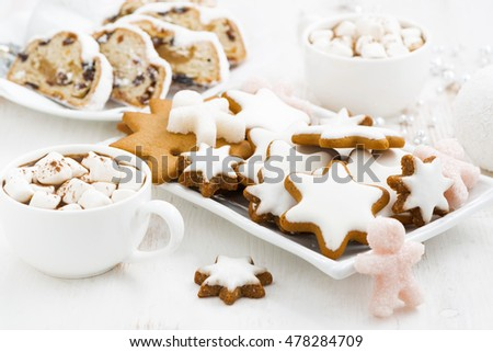 assortment gingerbread cookies, Christmas Stollen and hot cocoa, closeup