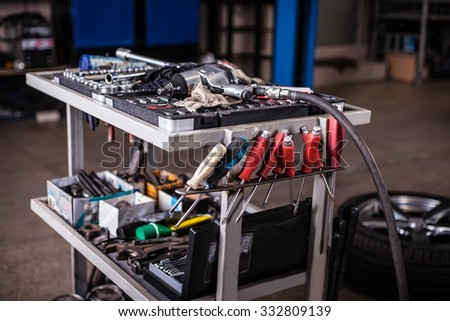 Assortment kit of tools in mechanic garage car service - stock photo