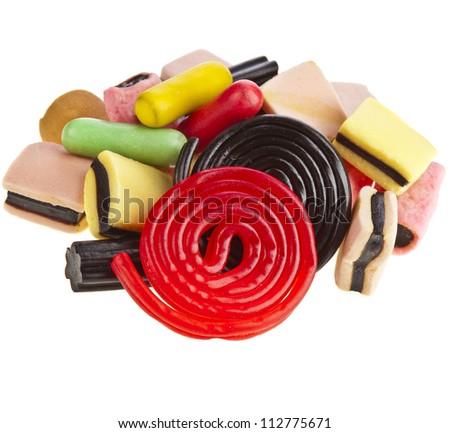 assortment  liquorice licorice candies isolated  on white background - stock photo
