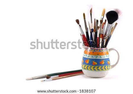 Assortment of artistic brushes - stock photo