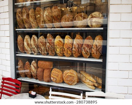 Assortment of baked bread in a bakery window display   - stock photo