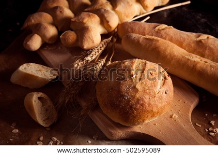 Assortment of baked bread on  table