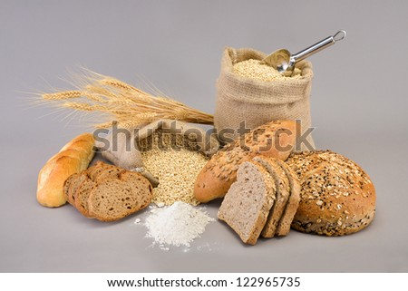 Assortment of baked bread over wheat sack
