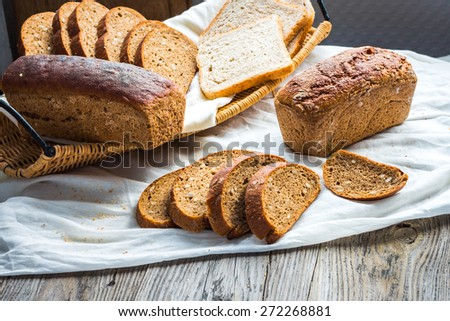assortment of baked bread, slices of rye bread, bran cereal, rustic - stock photo
