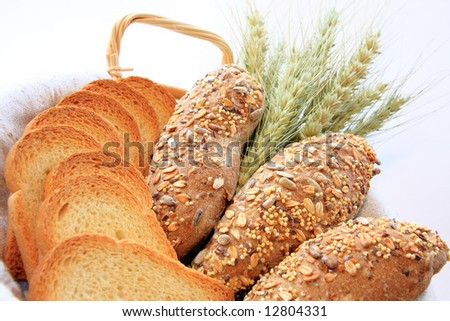 Assortment of baked bread with wheat isolated on white background - stock photo