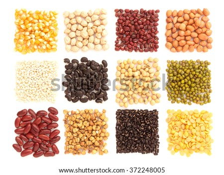 Assortment of beans and lentils  with wood box macadamia isolated on white . mung bean, groundnut, soybean, red kidney bean , black bean ,red bean and brown pinto beans . - stock photo