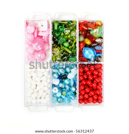 assortment of beautiful glass beads in a box - stock photo
