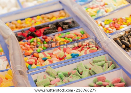 assortment of candies of different colors and flavors - stock photo