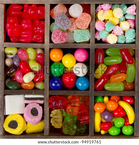 assortment of candy for a background, nine types in a printers box. - stock photo