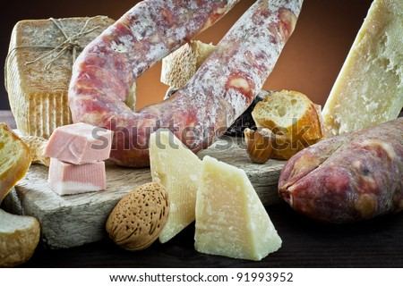 assortment of cheese and salami - stock photo