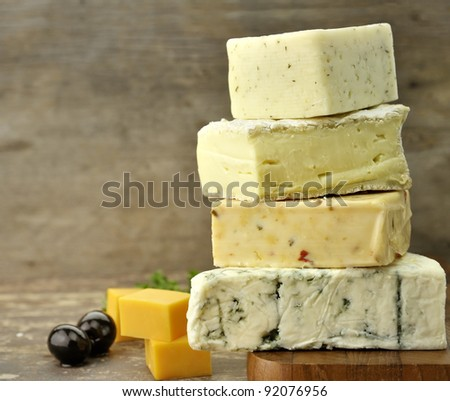 Assortment of Cheese On A Cutting Board