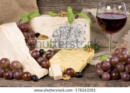 Assortment of cheese on a wooden surface