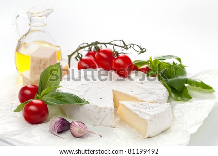 Assortment of cheese on white background - stock photo