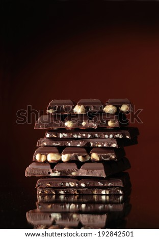 Assortment of chocolate bars with nuts   - stock photo