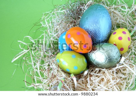 Assortment of chocolate Easter eggs wrapped in colorful paper - stock photo