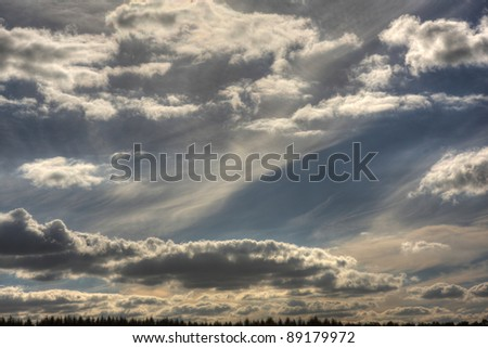 Assortment of clouds to create a dramatic blue stunning sky. - stock photo