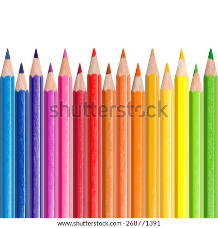 Assortment of colored pencils, isolated in front of white background, color concept