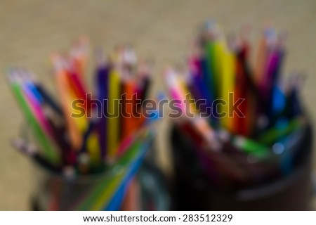 Assortment of colored pencilsColored Drawing PencilsColored drawing pencils in a variety of colors blurred