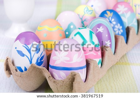 Assortment of colorful Easter eggs in a carton - stock photo