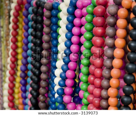 Assortment of colorful necklaces on a market-stand