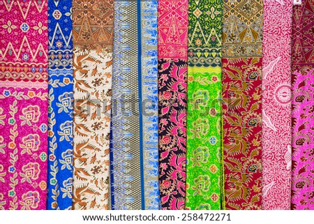 Assortment of colorful sarongs for sale, Island Bali, Ubud, Indonesia - stock photo