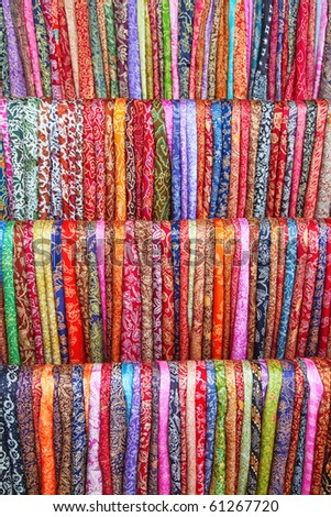Assortment of colorful sarongs for sale on the Balinese market - stock photo