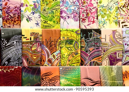 Assortment of colorful traditional Asian batik fabrics for sale in Kuala Lumpur, Malaysia - stock photo