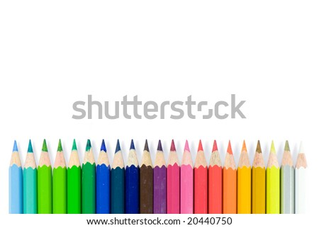 Assortment of colour pencils with shadow on white background