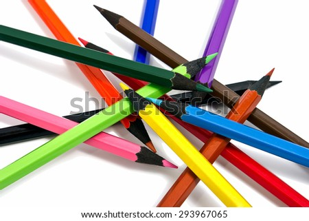 Assortment of coloured pencils on white background - stock photo