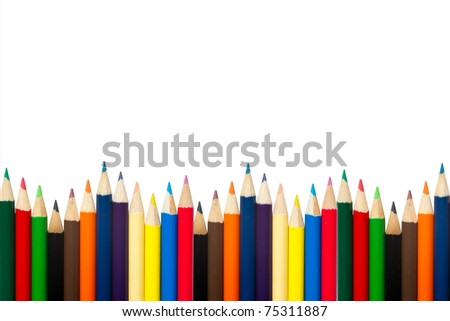 Assortment of coloured pencils with shadow on white background