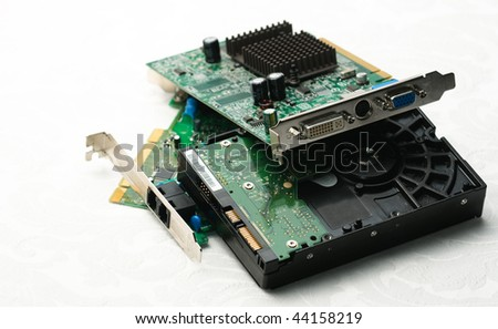Assortment of computer chips and hardware on white - stock photo