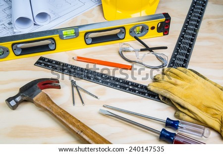 Assortment of construction tools randomly laid out. - stock photo