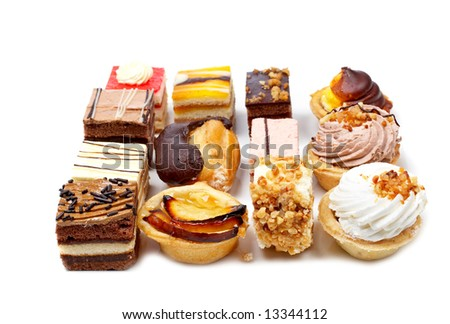 Assortment of delicious cakes with soft shadow on white plate. Shallow depth of field - stock photo
