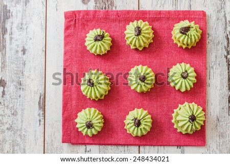 Assortment of delicious green cookies on colorful napkins - stock photo