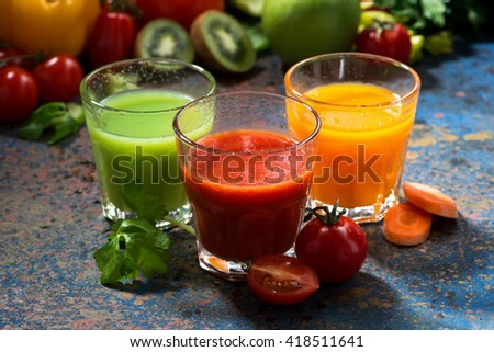 assortment of delicious vegetable juices on a blue background, horizontal