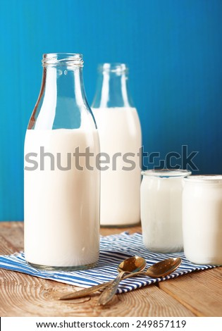 Assortment of diary products for breakfast (homemade yogurt and milk). Selective focus - stock photo