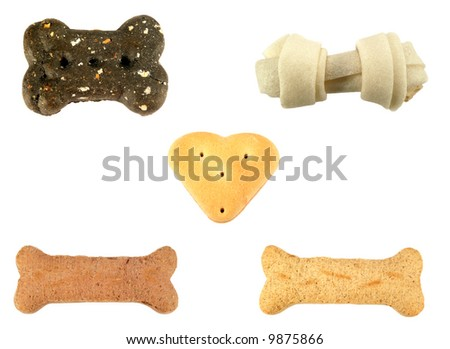 Assortment of different dog treats isolated over a white background